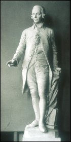 A marble statue of Adam Smith by the Austrian sculptor Hanns Gasser (1817-1868), c1867.  (Courtesy of the Hunterian Museum and Art Gallery (GLAHA Ref: 44315), University of Glasgow.)