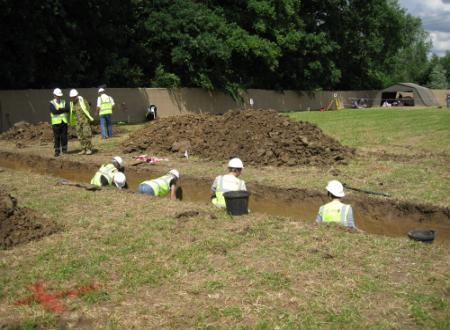 Excavations to evaluate the extent and preservation of a WWI mass grave at Fromelle, France