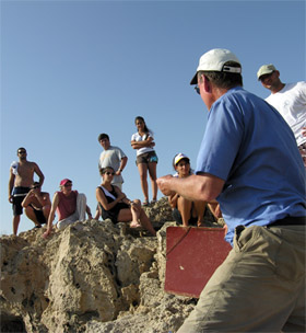 Bernard Knapp (3rd from left) and others listen to Albert Ammerman at the Late Epipalaeolithic/Early Aceramic Neolithic site of Nissi Beach, Cyprus