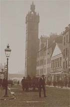 Photograph showing south end of High Steet, Glasgow, looking towards the Tolbooth, 1890s. Shows buildings, people and rear view of horse-drawn cart. (Photo B12, No 27) Links to more information about this item.
