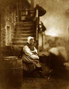 Newhaven fishwife, sitting on her steps