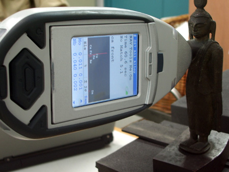 XRF analysis in progress on a bronze Buddha in Glasgow Museum Resource Centre
