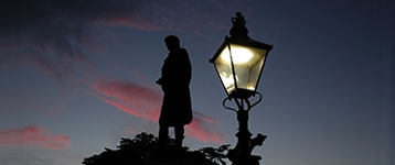 Robert Burns statue in Aberdeen at sunset