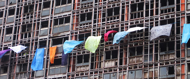 sheets hanging out of windows on a high rise flat