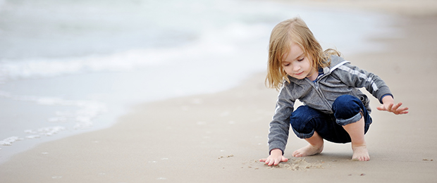 young girl playing on a beach
