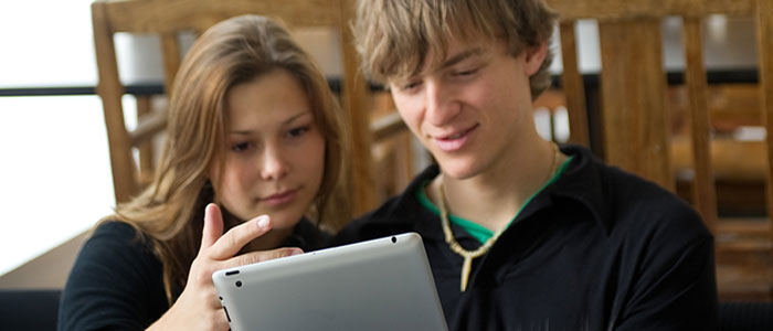 2 students looking at a tablet computer