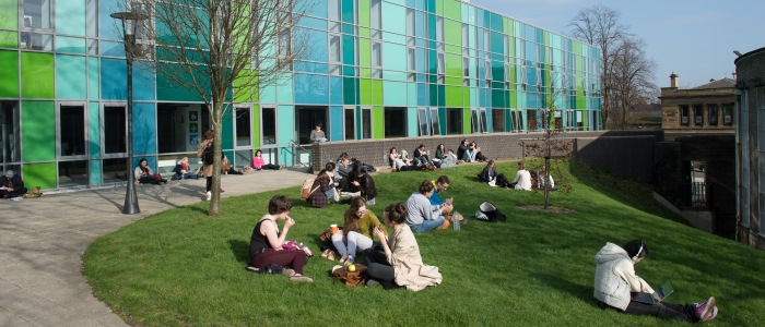 Students sitting outside the Fraser building