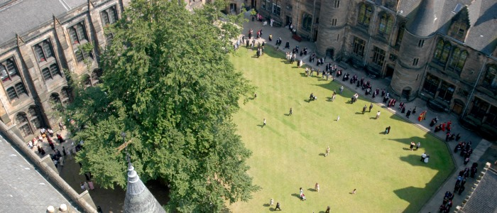 View of graduates in quadrangle from the roof of the main building