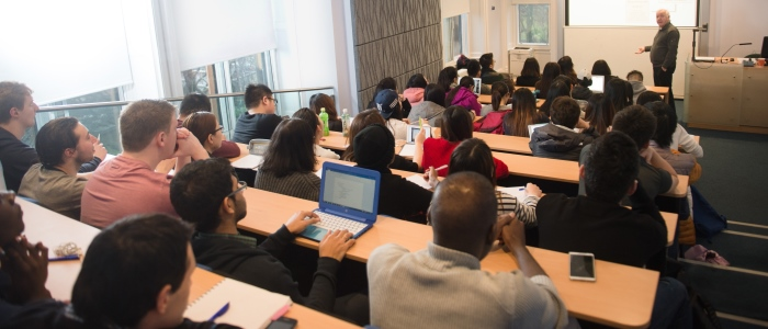 Several students in a lecture theatre