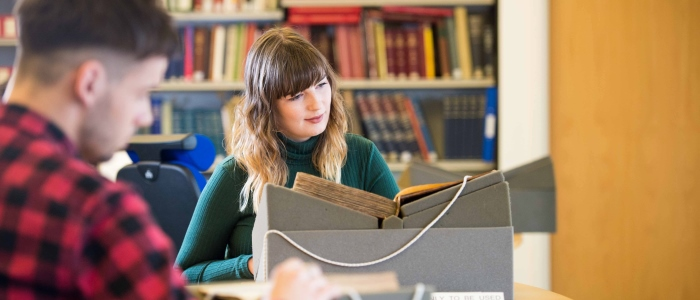 Student reading a Burns book