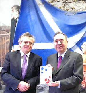 A photograph of Professor Murray Pittock and Alex Salmond in front of the Scottish flag