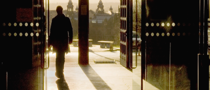 Image of a person standing by the South Entrance to the Main Building. This image links to a sign-up form for the Knowledge Exchange newsletter.