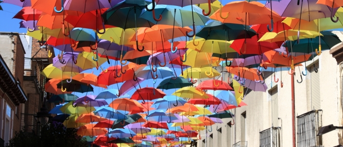 Image of colourful umbrellas above a street in Madrid
