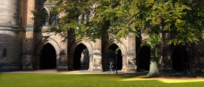 Two students sitting in the cloisters