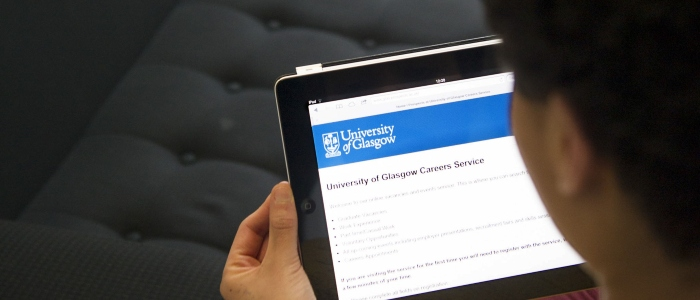 a student viewing Careers Service info on a tablet device