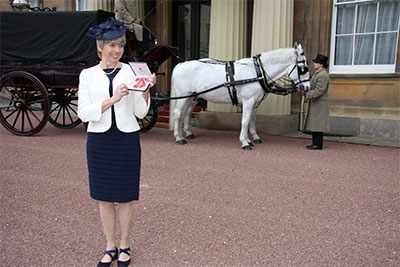Prof. Sarah Cleaveland is awarded an OBE at Buckingham Palace, February 2015