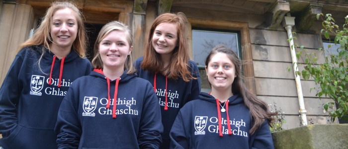 Four Gaelic language students outside University Gardens