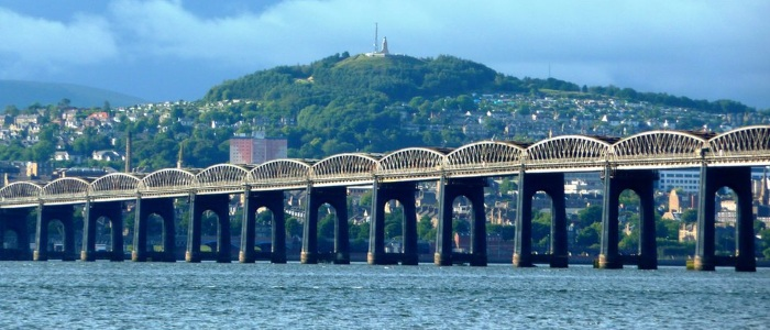 A view of Dundee railway bridge with the city of Dundee and Law Hill in the background