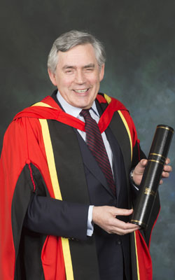 Image of Gordon Brown holding his honorary degree, awarded in April 2015