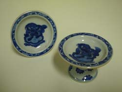 Pair of Blue and White ceramic salt stands from Whistler's ceramics collection. GLAHA 54422 and 54577. Decorated with Chinese imagery, mythological creature