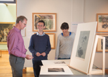 Hunterian curator Peter Black with colleagues looking at German Expressionist prints in the Hunterian Art Gallery.