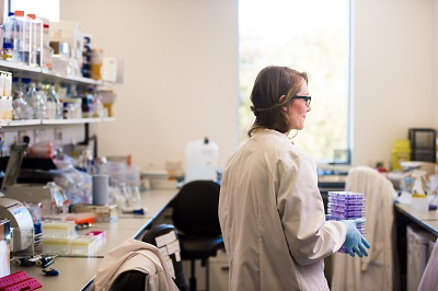 Image of a female PhD student working in a lab