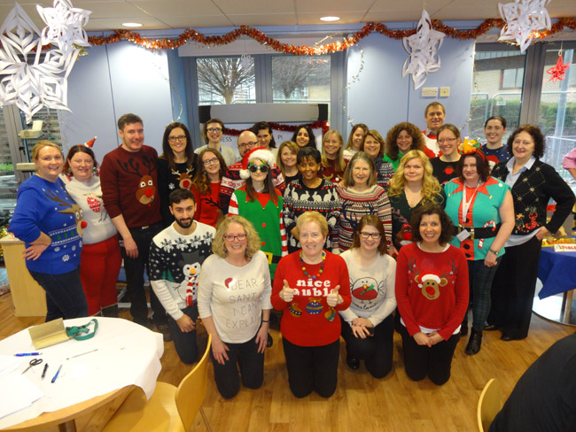 Image of the fund-raising WTCMP staff in their Christmas jumpers