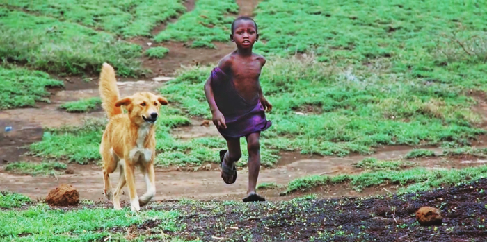 Boy with dog in Tanzania. Credit Katie Hampson