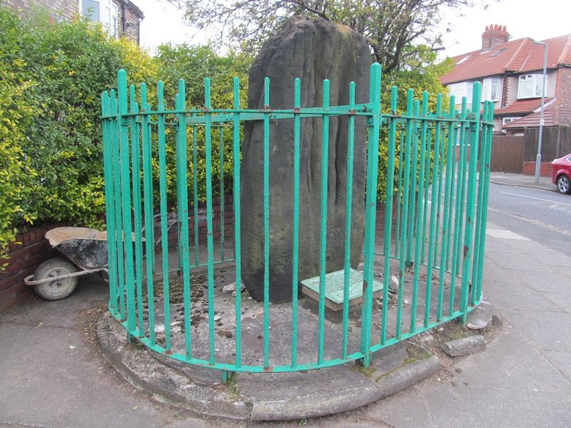 Robin Hood's Stone, a roadside caged megalith in a suburb of Liverpool