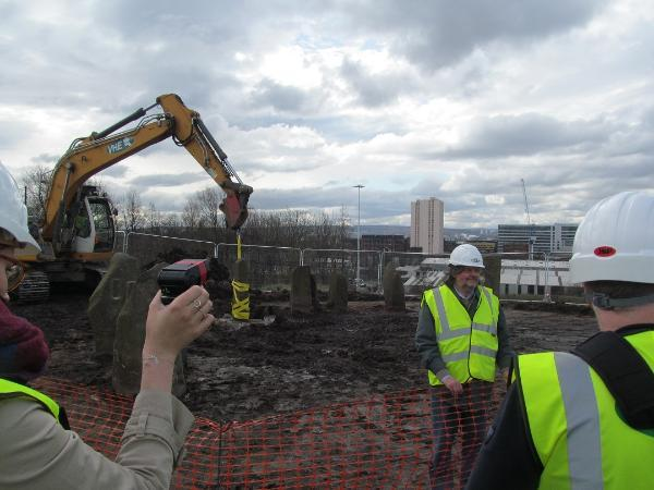 The dismantlement of the Sighthill stone circle in Spring 2016, with its designer, Duncan Lunan, standing in the foreground