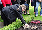 Image of a cross being planted in the garden of remembrance