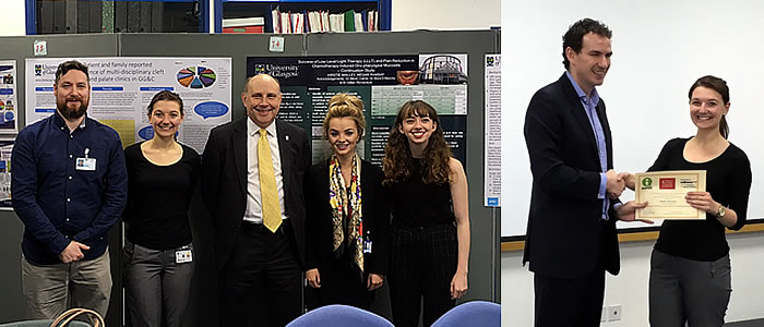 Students in front of posters and receiving award
