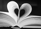 A book with two pages turned in to form a heart