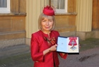 Professor Dame Anna Dominiczak at Buckingham Palace with her damehood