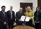 Image of NLU and University of Glasgow staff signing an MoU