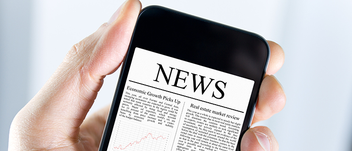 Image of a mobile phone with news displayed