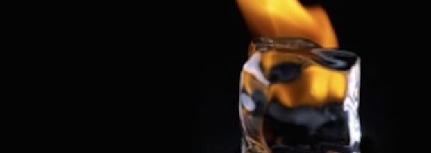 An photograph of an ice cube with flames behind it. Taken with permission from the 'Value of Suffering' project website.