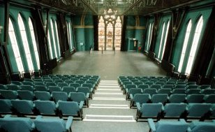modern theatre seating inside an old church