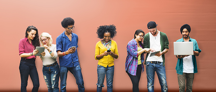 Image of diverse group of people looking at mobile devices