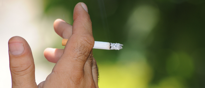 Close up of hand and cigarette