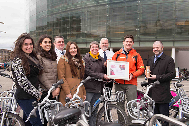 Image of the University cycling and active travel team being presented with the Cycle Friendly Campus award.