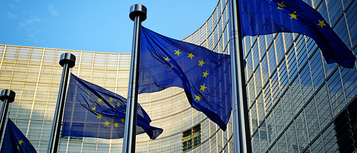 Image of European Union flags flying outside the EU headquarters in Brussels