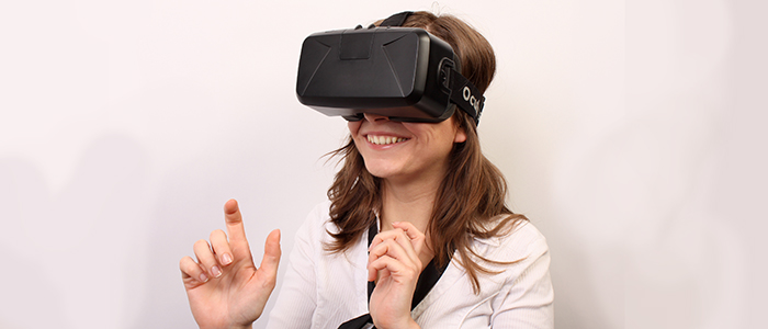 Image of a woman wearing a virtual reality head set