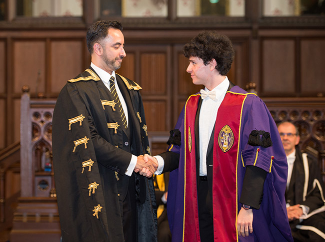Image of Aamer Anwar, newly installed Rector, shaking hands with SRC President Ameer Ibrahim