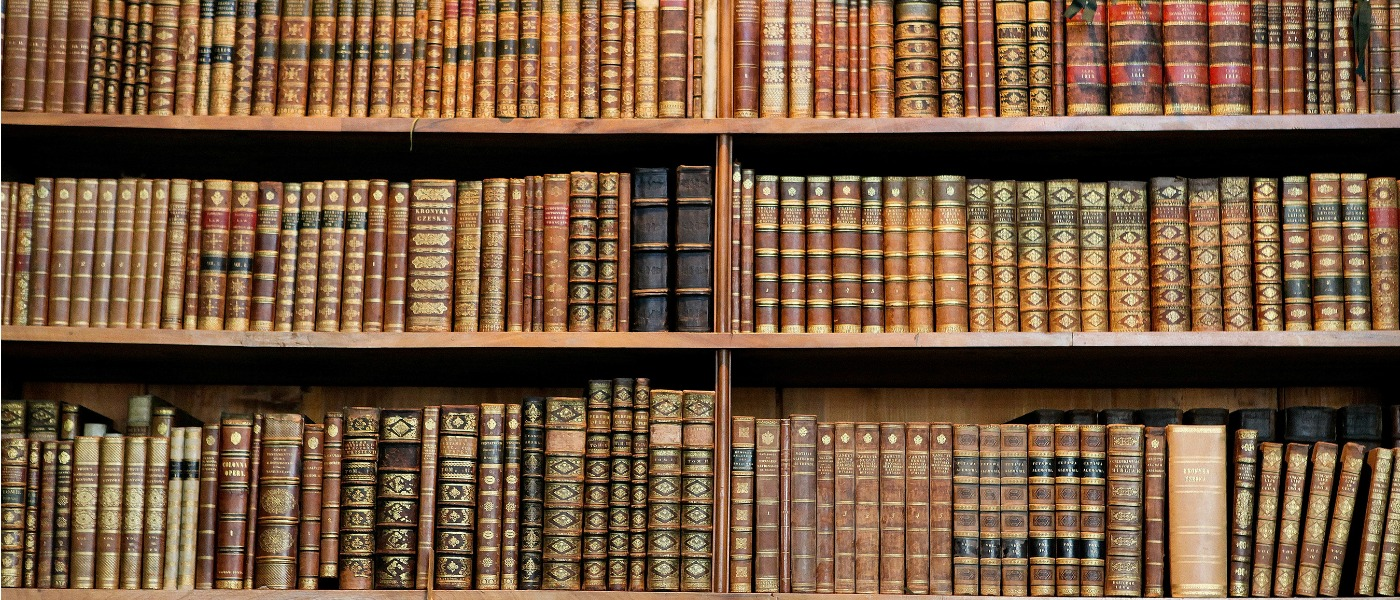 Image of old books in a library