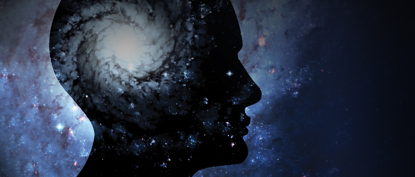 Conceptual image of a human head and the universe.