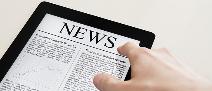 Image of a tablet with the word news displayed