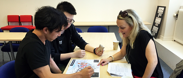 Image of international students chatting with Estates and Buildings Assistant Director, Nicola Cameron.