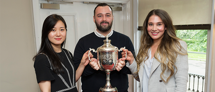 Students with trophy for Raymond Miquel Enterprise Award