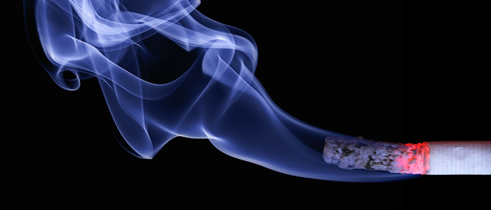 Image of a lit and burning cigarette with ash